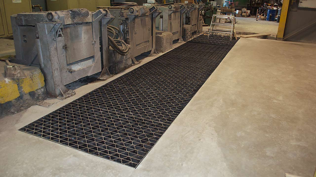 New grating over dump pit in front of melt furnaces.